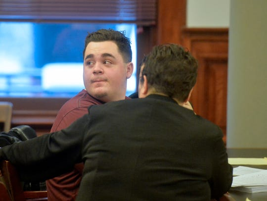 Joseph Knowles turns to see his family leave the courtroom