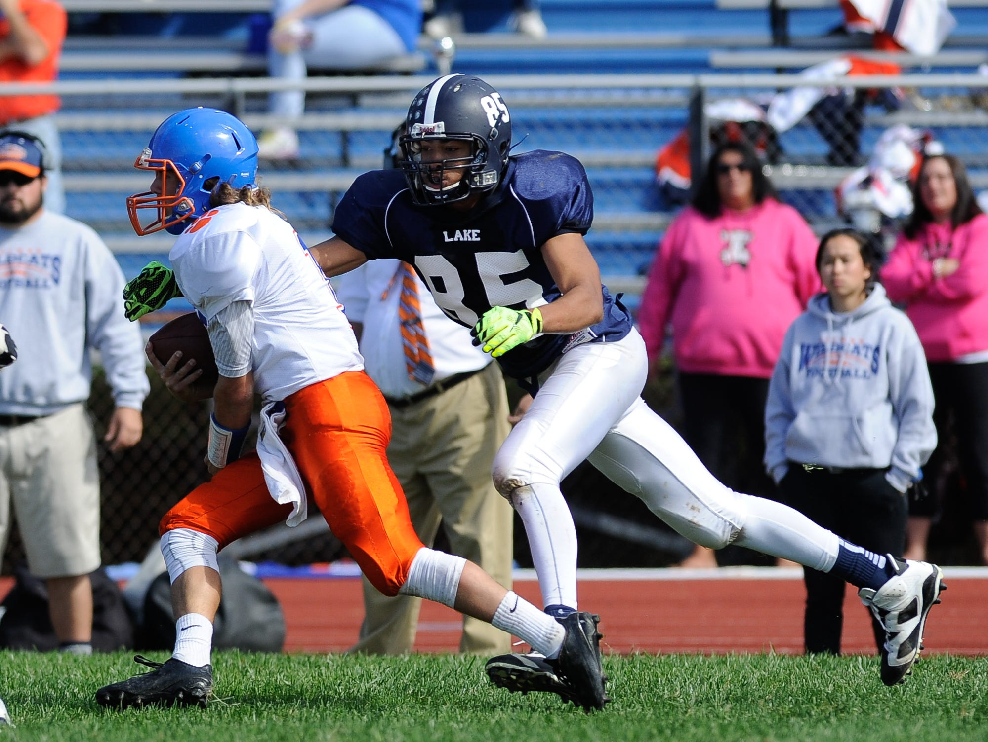 Lake Forest's #85 Cameron Lewis with a tackle on Delmar's quarterback #1 James Adkins in their 19-14 win over Delmar on Saturday at Lake Forest High School.