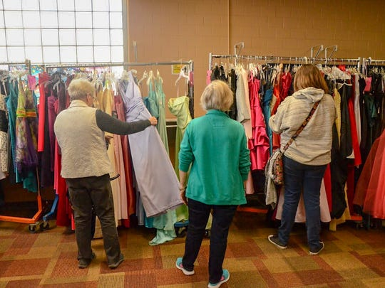 Volunteers were there at the Charitable Union to work as personal shoppers for the students, helping them pick out dresses.