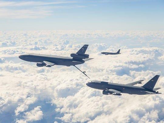 An Air Force KC-10 fuels a next-generation KC-46 on a test flight.