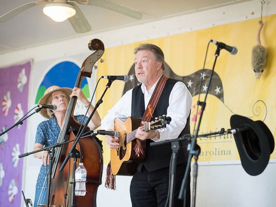 Ballad singer and songwriter Joe Penland, winner of the prestigious Lunsford Award in 2005, performs alongside bassist Cathy Arrowood on the Lunsford Festival stage.