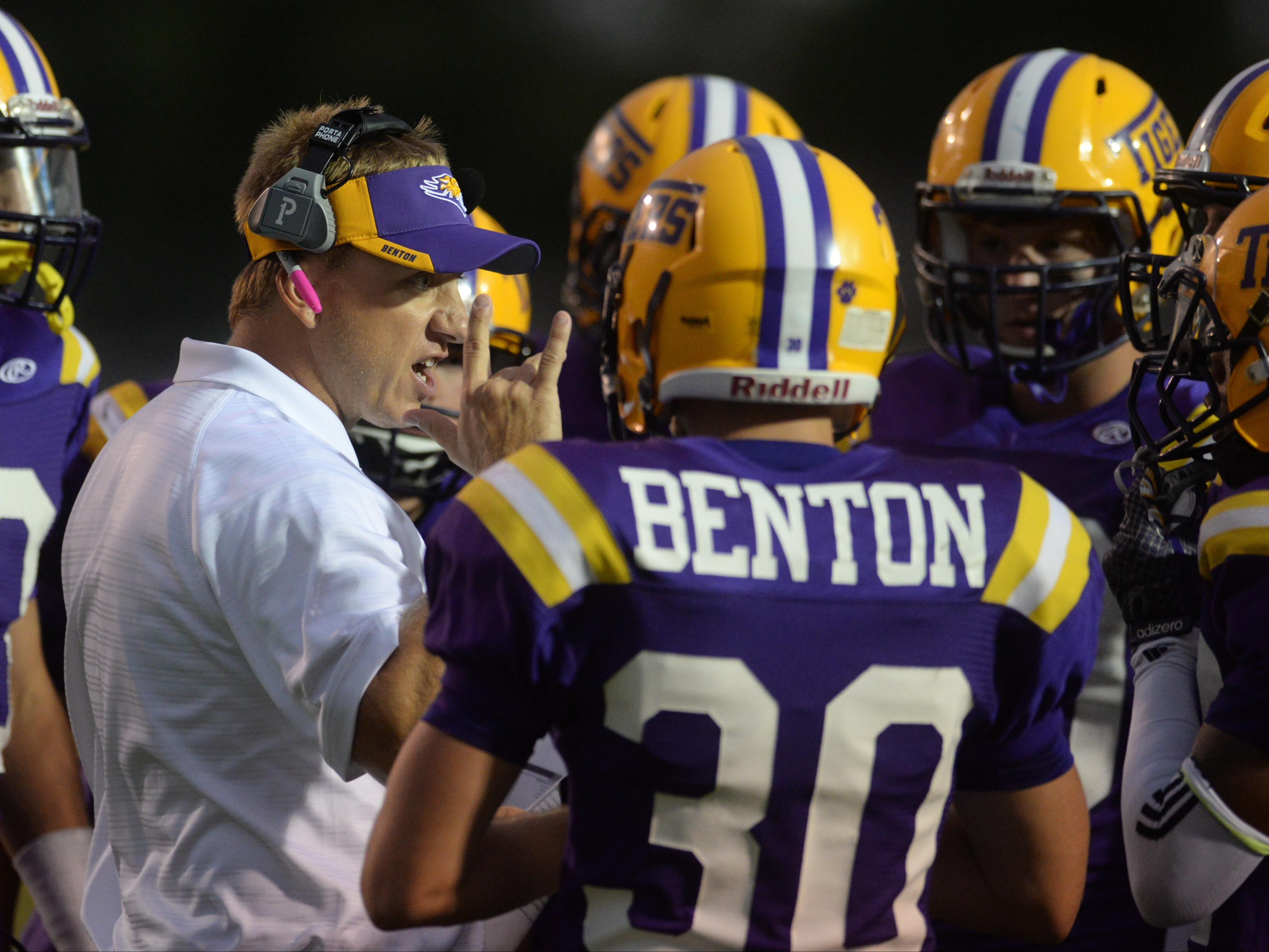 Benton's head coach Reynolds Moore talks with his team in an earlier game.