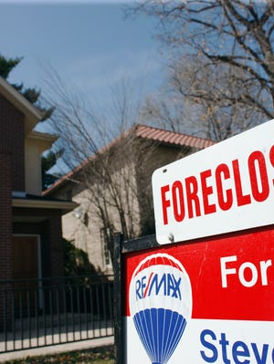 File photo from 2010 shows a a single-family home in foreclosure in Denver.