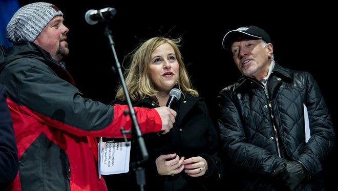From left, Storme Warren, Nashville Mayor Megan Barry and Peter Frampton count down for the London countdown to midnight in the United Kingdom during the Jack Daniel's Music City Midnight: New Year's Eve held at Bicentennial Capitol Mall State Park in Nashville, Tenn., Sunday, Dec. 31, 2017.