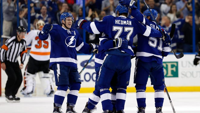 Lightning defenseman Victor Hedman (77) celebrates with teammates after scoring a goal against the Flyers.
