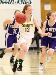 Ashley Dubuque of BFA surveys the court during the Comets 52-26 semifinal win over Brattleboro.