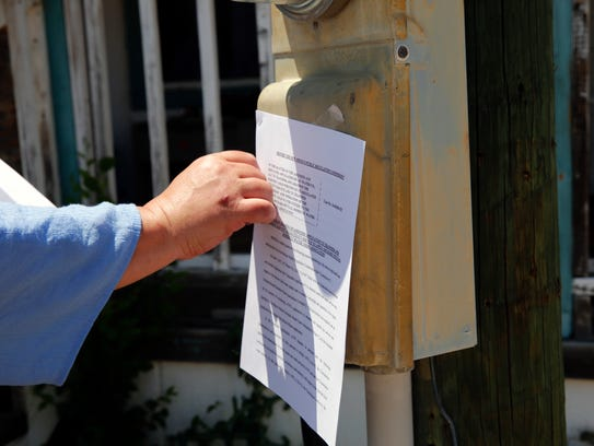 AV Water attorney Germaine Chappelle places a notice