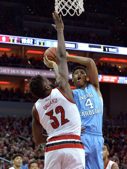 North Carolina's Isaiah Hicks (4) attempts to shoot over the defense of Louisville's Chinanu Onuaku (32) during the first half of an NCAA college basketball game, Monday, Feb. 1, 2016, in Louisville, Ky. (AP Photo/Timothy D. Easley)