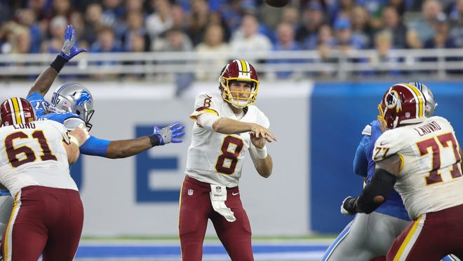 Redskins QB Kirk Cousins passes during the first half  Sunday at Ford Field.
