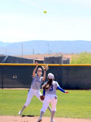 Carlsbad's Jennifer Munro catches a pop fly in Thursday's 6A state tournament opener against Cibola.