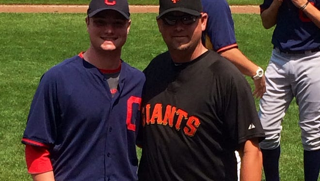 Logan Allen, left, and former Roberson baseball coach Donnie Suttles were together at last week's East Coast Pro Showcase in Syracuse, N.Y.