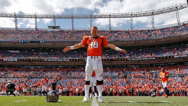 Denver Broncos quarterback Peyton Manning stretches prior to a game against the Kansas City Chiefs, Sunday, Sept. 14, 2014, in Denver.