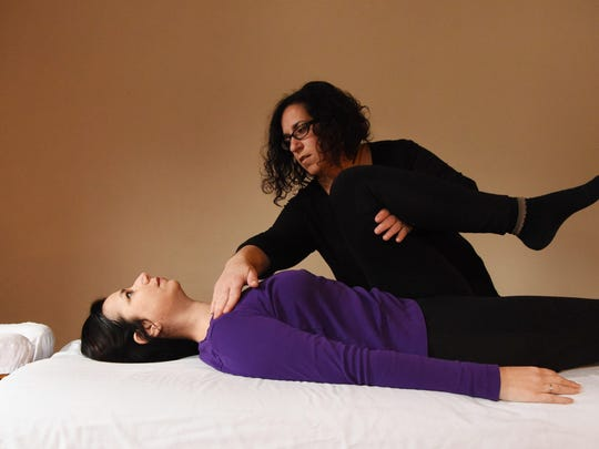 Professional Bowenwork practitioner Danielle Molella, right, practices Bowen Therapy on columnist Linda Freeman.