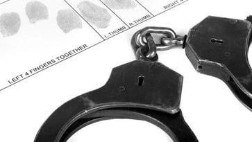 Handcuff and fingerprints.