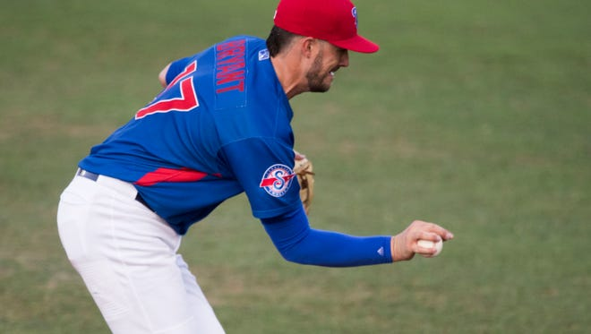 Third baseman Kris Bryant makes a bare-handed catch on a ground ball Monday.