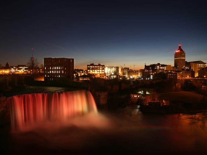 Sunset at High Falls in downtown Rochester Wednesday,