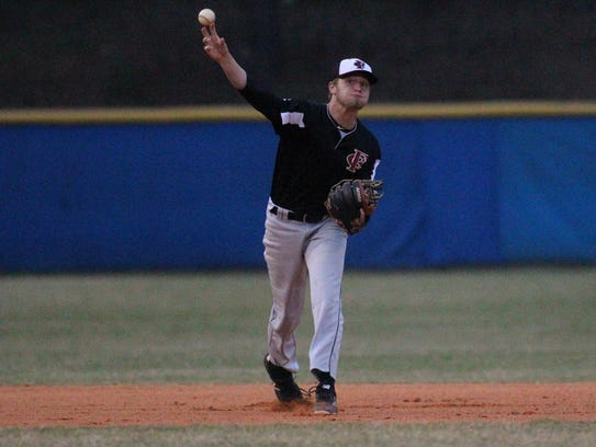 Franklin County shortstop Christian Amison throws to