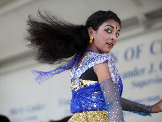 Shweta Vazhappilly, 16, of Montville from the Kalashri School of Arts performs at the annual India Day festival, Aug. 16, 2014 at the Rockland County Courthouse grounds in New City. The India Cultural Society of Rockland started off with a parade on Main Street followed by a cultural program and Indian vendors at the festival.