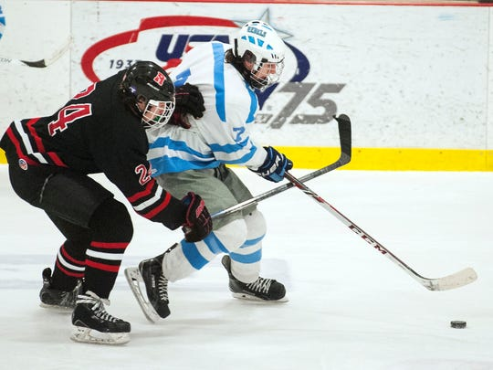 South Burlington's Brendan Lahue (7) skates past Rutland's Bauer Hill (24) during the boys hockey game between the Rutland Raiders and the South Burlington Rebels at Cairns Arena on Saturday December 27, 2014 in South Burlington, Vermont.