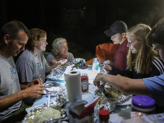 Seacrest Country Day School students and staff gather for dinner Saturday, Aug.19, 2017, in Blue Ridge, Ga. The group made the trek to Georgia to witness the solar eclipse from the path of totality.