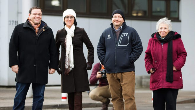 Freed journalist Jason Rezaian, second from right, and his family at the U.S. military hospital in Germany in January 2016.