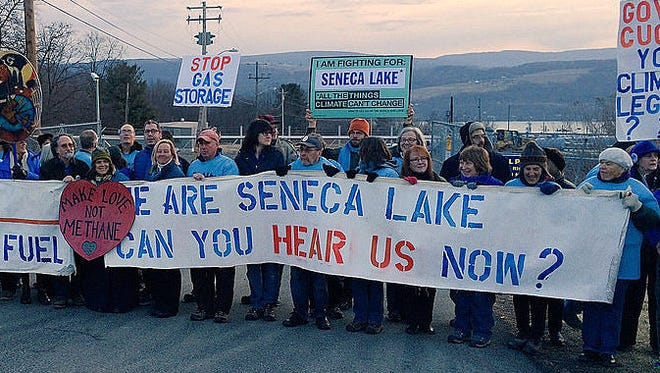 Protesters block the gate at the Crestwood Midstream facility on Seneca Lake earlier this year.