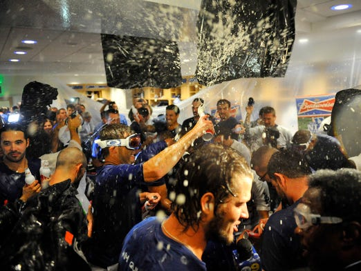 Game 4 -- Dodgers 4, Braves 3: The Dodgers celebrate their 4-3 victory against the Braves.