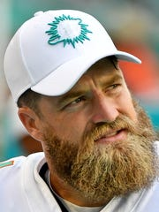 Sep 8, 2019; Miami Gardens, FL, USA; Miami Dolphins quarterback Ryan Fitzpatrick (14) looks on from the bench during the second half against the Baltimore Ravens at Hard Rock Stadium. Mandatory Credit: Jasen Vinlove-USA TODAY Sports