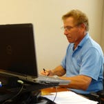 City Manager Roger Hernstadt works at his desk earlier this week.
