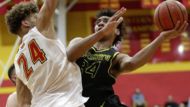 Galesburg's Jaylin McCants puts up a shot over Rock Island's Taurean Holtam on Friday, Feb. 21 in a Western Big 6 game at Rocky.