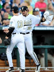 Vanderbilt's Ben Bowden (35) congratulates Walker Buehler after striking out a TCU hitter during the second inning in the College World Series at TD Ameritrade Park, Friday, June 19, 2015, in Omaha, Neb.
