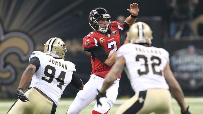 Atlanta Falcons quarterback Matt Ryan (2) runs out of the pocket under pressure by New Orleans Saints defensive end Cameron Jordan (94) and New Orleans Saints strong safety Kenny Vaccaro (32) during a game last season.