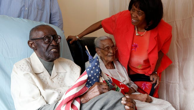 Marie Yoland Eveillard speaks with her father Duranord Veillard, who will celebrate his 108th birthday on Saturday, and mother Jeanne Veillard, in Spring Valley. Jeanne turns 105 in May. The couple got married in Haiti in 1932.