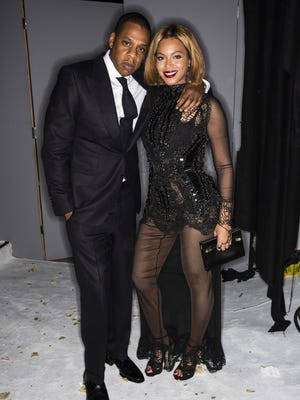 LOS ANGELES, CA - FEBRUARY 20:  In this handout provided by Tom Ford, rapper Jay Z and singer Beyonce attend the Tom Ford Autumn/Winter 2015 Womenswear Collection Presentation at Milk Studios on February 20, 2015 in Los Angeles, California.