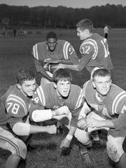 Leon quarterback Billy Sexton (12) hands off in 1966