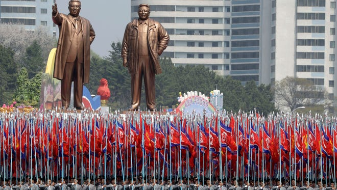 In this Saturday, April 15, 2017, photo, bronze statues of late leaders Kim Il Sung and Kim Jong Il are paraded across Kim Il Sung Square during a military parade to celebrate the 105th birth anniversary of Kim Il Sung in Pyongyang, North Korea.
