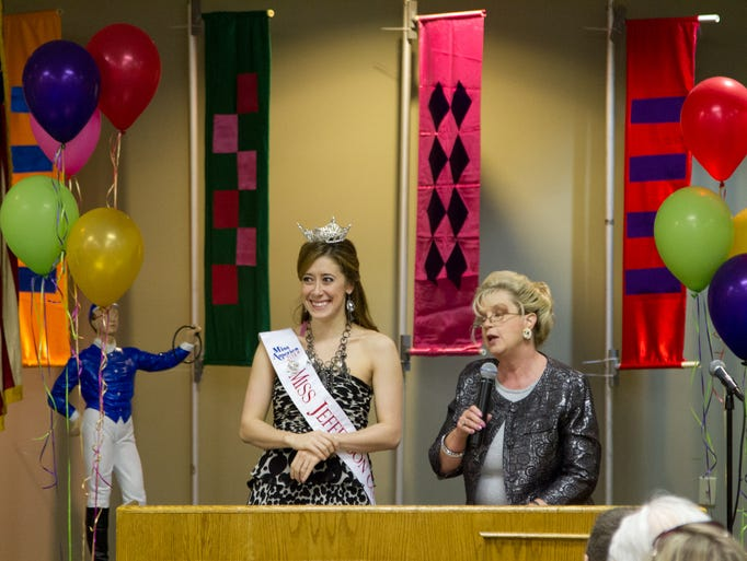"""2013 Miss Jefferson County, Ashley Ferry, left, and The Wright Stuff Consignment Store owner, Laura Wright, announce models onto the stage during the """"Everything Derby"""" event at the Middletown Library. March 15, 2014."""