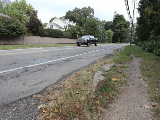 A vehicle travels along Forest Avenue north of Apawamis