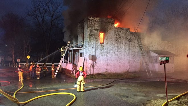 Firefighters from at least three departments battle a blaze in downtown Calico Rock early Monday evening.