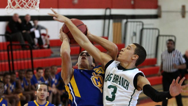 Fred Reeves (3) of Long Branch defends against Logan Santiago (20) of Marist during Neptune Holiday Jubilee basketball tournament at Neptune High School. Friday, December 26, 2014. Neptune,NJ. Noah K. Murray-Special for the Asbury Park Press ASB 1227 Long Branch vs. Marist Bball Gamer
