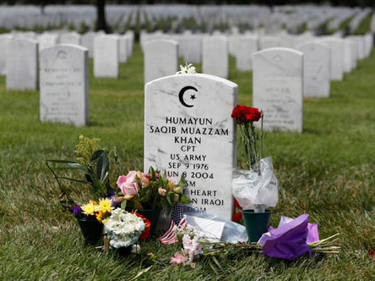 The tombstone of US Army Capt. Humayun S. M. Khan is seen in Section 60 at Arlington National Cemetery in Arlington, Va., Monday, Aug. 1, 2016. Fellow Republicans are joining the rising chorus of criticism of Donald Trump for his disparagement of the bereaved parents of U.S. Army Capt. Humayun Khan, a Muslim who was awarded a Bronze Star after he was killed in 2004 in Iraq.  (AP Photo/Carolyn Kaster)