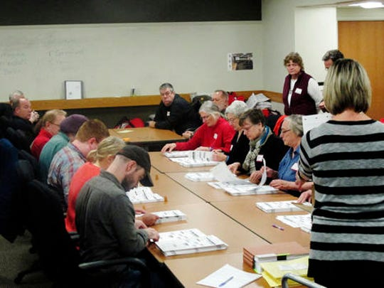 Ballots from the town of Middleton, Wis., are placed in front of workers as a statewide presidential election recount begins, Thursday, Dec. 1, 2016, in Madison, Wis. The first candidate-driven statewide recount of a presidential election in 16 years began Thursday in Wisconsin, a state that Donald Trump won by less than a percentage point over Hillary Clinton after polls long predicted a Clinton victory.