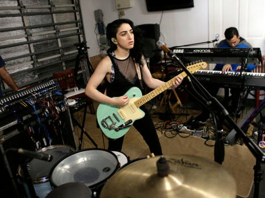 "In this Jan. 31, 2017 photo, Emily Estefan practices with her band in the garage of her late grandparent's mansion in Miami Beach, Fla.Estefan, the daughter of Gloria and Emilio Estefan released her debut album,"" ""Take Whatever You Want,"" on Feb. 3."