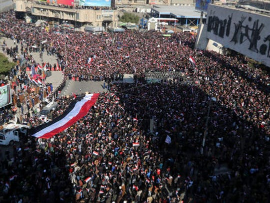 Followers of Iraq's influential Shiite cleric Muqtada al-Sadr chant slogans as they wave national flags during a demonstration against corruption in Baghdad, Iraq, Saturday, Feb. 11, 2017.