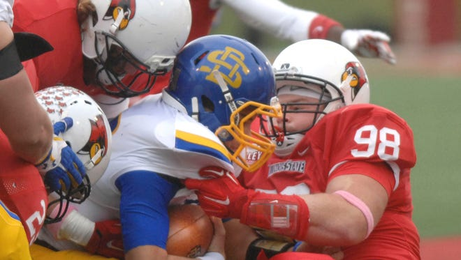South Dakota State's Zach Zenner 31 is dragged down by Illinois State University Dalton Keene, 98 in the  first quarter of play at Hancock Stadium in Normal, Illinois, Saturday, Oct. 4, 2014.