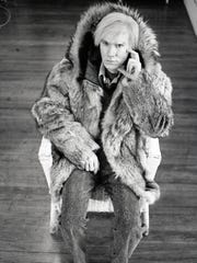 "Michael Childers took this photo of Andy Warhol in his New York studio after Warhol showed an attraction to a fur coat. The photo is included in the Palm Springs Art Museum's ""Photographs of Michael Childers: Having A Ball."""