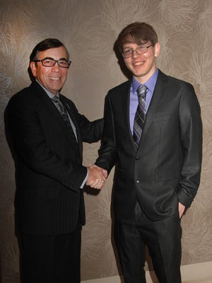 Gabriel Gustavson (right) is congratulated by Mayor Rob Moon for being named Youth of the Year 2017 by the Boys and Girls Club of Palm Springs.
