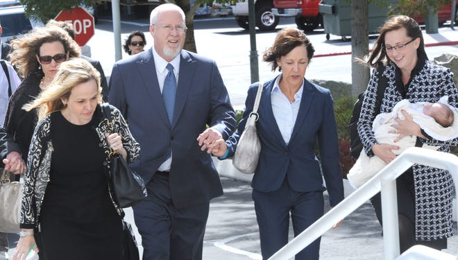 Harvey Whittemore, third from right, and family members enter federal court Sept. 30, 2013, in Reno, Nev., for Whittemore's sentencing.