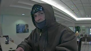 Greenville County deputies released a surveillance photo in attempt to locate the man responsible for the robbery of a SunTrust Bank in Berea Monday.