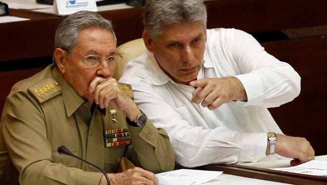 Cuban President Raul Castro, left, and Vice President Miguel Diaz-Canel attend the opening of a legislative session at the National Assembly in Havana, Cuba, on July 6, 2013.